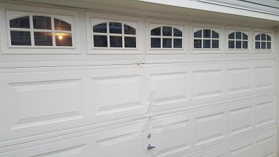 Garage Door Bent Panel Seattle - Elite Tech Services, LLC