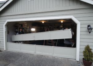 Garage Door Bent Panel Repair In Kirkland WA By Elite Tech Services, LLC