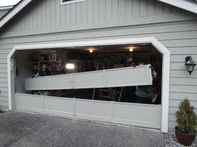 Garage Door Bent Panel Repair In Kirkland WA By Elite Tech Services, LLC